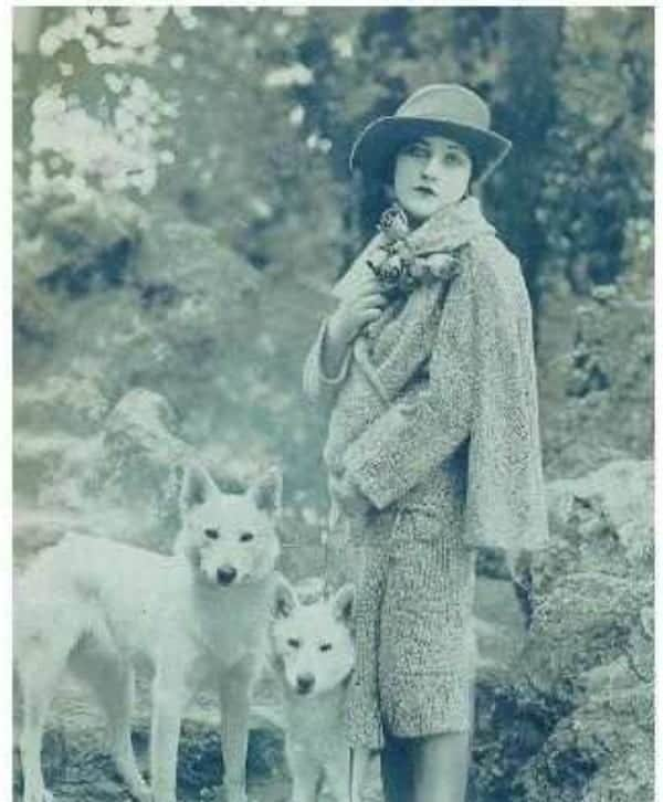 Anne Tracy in 1919 with white german shepherd puppies