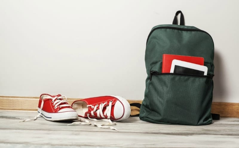 backpack and shoes on floor
